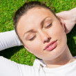 Young beautiful woman on the grass with closed eyes — Stock Photo #10084968