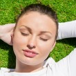 Young beautiful woman on the grass with closed eyes — Stock Photo #10085017