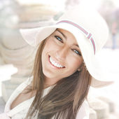 Closeup portrait of a beautiful young woman having a happy thoug — Stock Photo