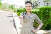 Pretty adult woman giving handshake near detached house. Real estate agent reaching agreement — Stock Photo