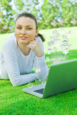 Pretty woman using wireless internet connection to communicate with her friends during her vacation at summer park — Stock Photo