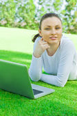 Beautiful young woman using laptop at outdoor — Stock Photo