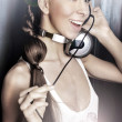 Club style woman with headphones listening to music — Stock Photo