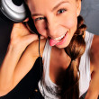 Club style woman with headphones listening to music looking away. Top View. — Stock Photo