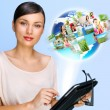 Portrait of young woman holding her tablet computer and communicating with her friends across the world. Standing against world map with photo of . International communications concept — Stock Photo