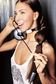 Club style woman with headphones listening to music looking away — Stock Photo