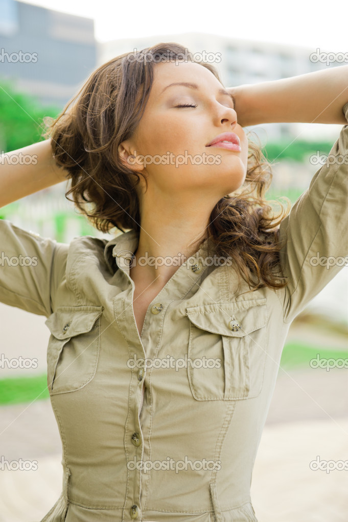 Portrait of a sexy young femalewith closed eyes smiling and breathing fresh air at morning in a park - Outdoor — Stock Photo #10344825