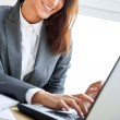 Beautiful business woman dreaming while working on computer at h — Stock Photo #10580639