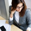 Adult young pretty business woman working at her office — Stock Photo