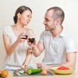 Young love couple cooking and drinking red whine from beautiful — Stock Photo