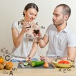 Young lovely couple cooking a balanced diet. Big copyspace. Vita — Stock Photo #10580711