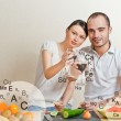 Young lovely couple cooking a balanced diet. Big copyspace. Vita — Stock Photo #10580722