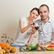 Young lovely couple cooking a balanced diet. Big copyspace. Vita — Stock Photo #10580735
