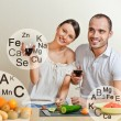 Young lovely couple cooking a balanced diet. Big copyspace. Vita — Stock Photo #10580747