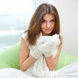 Portrait of a charming woman holding a cup of tea and daydreamin — Stock Photo #10580775