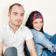 Attractive young couple sitting in their home — Stock Photo