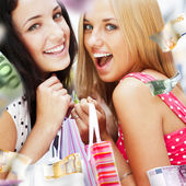 Group of beautiful shopping women with bags and smiling — Stock Photo