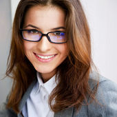 Beautiful young business woman wearing glasses sitting relaxed a — Stock Photo
