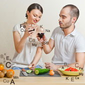 Young lovely couple cooking a balanced diet. Big copyspace. Vita — Stock Photo
