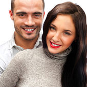 Portrait of young couple standing together isolated against whit — Stock Photo