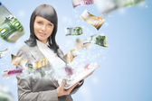 Portrait of a happy brunette woman with tablet computer - money — Stock Photo