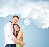 Portrait of young couple standing together and embracing — Stock Photo