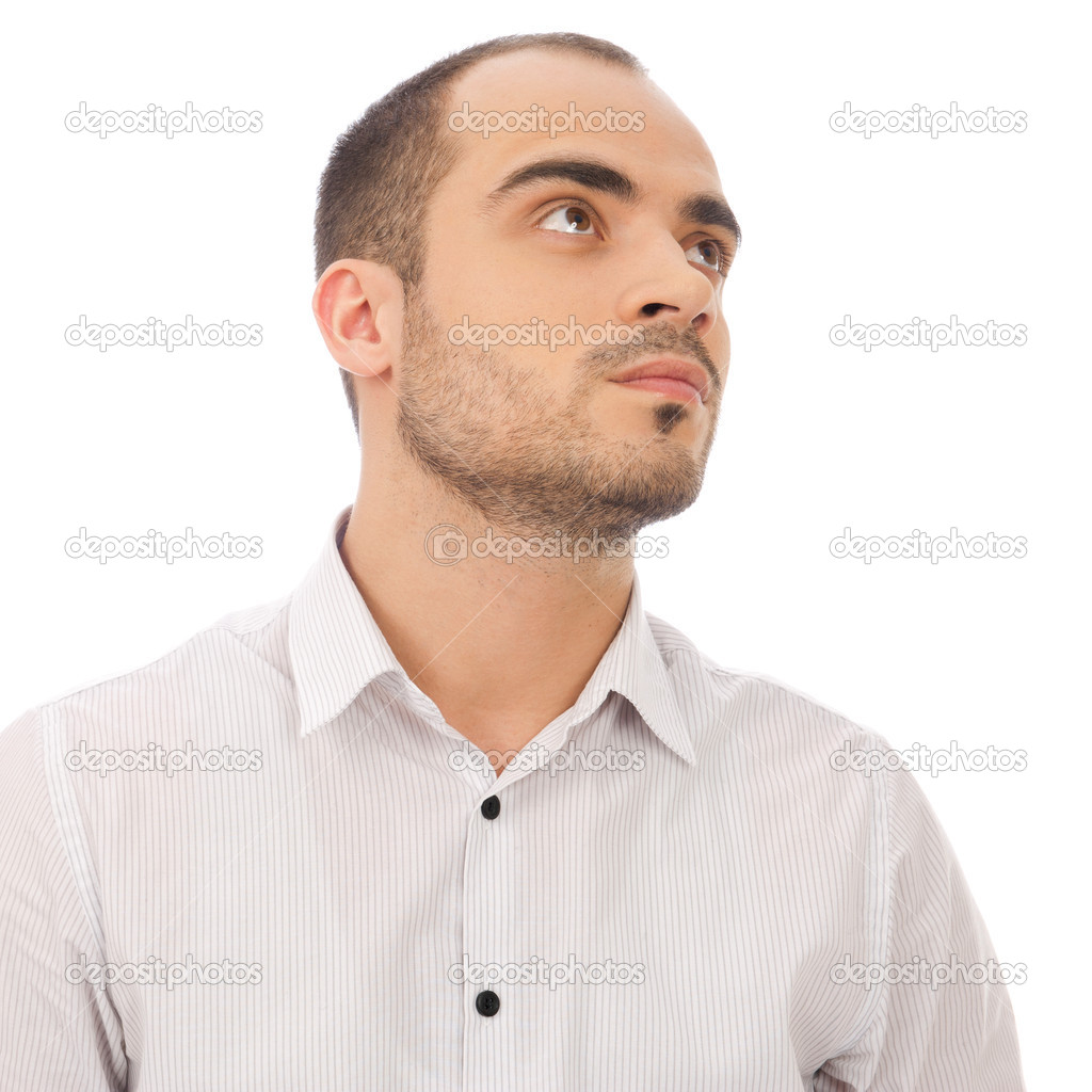 Thinking man isolated on white background. Closeup portrait of a casual young pensive businessman looking up. Caucasian male model.  Stock Photo #10580849