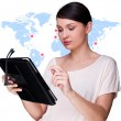 Portrait of young woman standing in fron of big world map and lo — Stock Photo