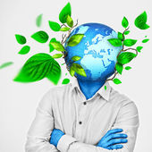 Man with earth enclosed and growing instead of his head — Stock Photo