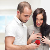 Young man making love proposal to a lady of his choice at their — Stock Photo
