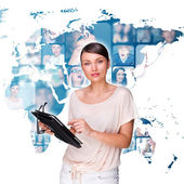 Portrait of young pretty woman working on modern tablet computer — Stock Photo