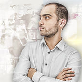 Portrait of young businessman. Standing against world map with p — Stock Photo