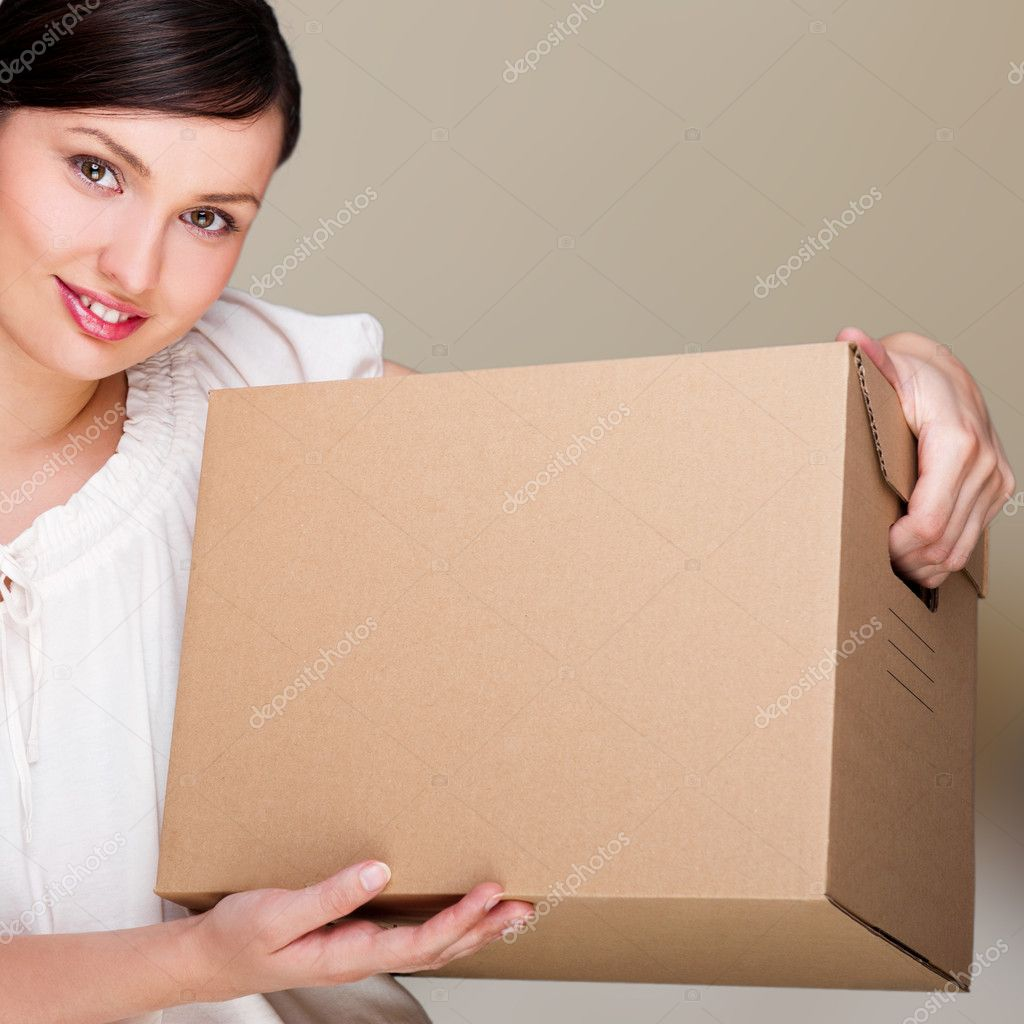 Young woman moving into a new home. Great copy space. — Stock Photo #10596212