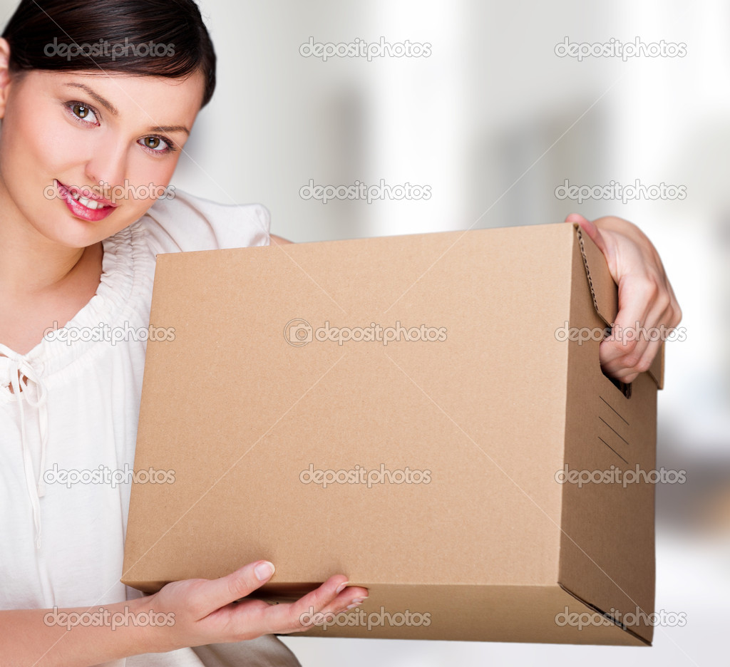 Young woman moving into a new home. Great copy space. — Stock Photo #10596284