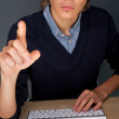 Young business man pressing a touchscreen button while working a - Stock Photo