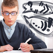 High school - Young male student write notes in classroom. Desig — Stock Photo