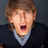 Portrait of young handsome shocked good looking man working usin — Stock Photo