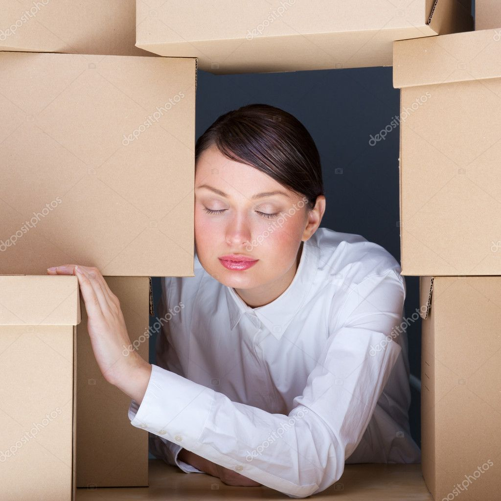 Portrait of young woman surrounded by lots of boxes. Lots of work concept. — Stock Photo #10663001