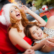 Young happy familye near a Christmas tree at home holding gift a — Stock Photo #8202957