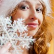 Royalty-Free Stock Photo: Christmas woman by snowflake