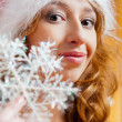 Christmas woman by snowflake — ストック写真