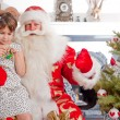 Christmas theme: Santa Claus and little girl having a fun. Indoo — Foto Stock