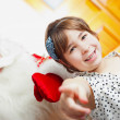 Christmas theme: Santa Claus and little girl having a fun. Indoo — ストック写真