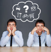 Image of two young similar men thinking of their plans sitting t — Stock Photo