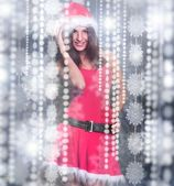 20-25 years od beautiful woman in christmas dress dancing around — Stock Photo