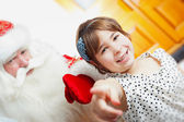 Christmas theme: Santa Claus and little girl having a fun. Indoo — Stock Photo