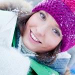 Beautiful young lady having fun outdoors in winter — Stock Photo #8659795