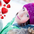 Beautiful and cheerful young lady in a happy mood outdoors in wi — Stock Photo #8659806