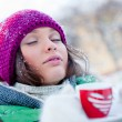 Young beautiful girl day dreaming outdoors in winter while havin — Foto de Stock