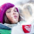 Young beautiful girl dreaming of love outdoors in winter while h — Stock Photo